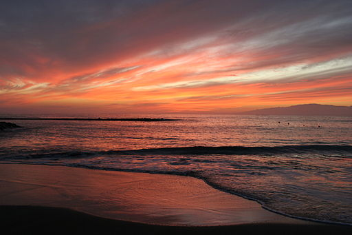 By Tony Hisgett from Birmingham, UK (Fanabe beach sunset 1) [CC BY 2.0], via Wikimedia Commons