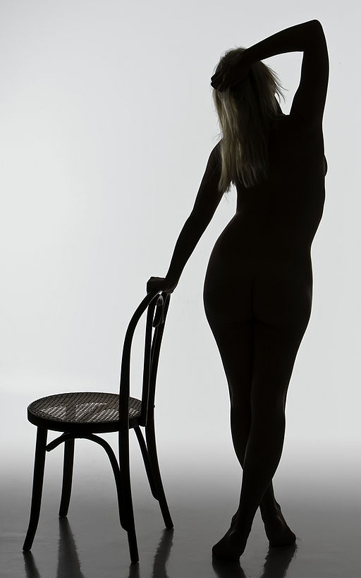 Woman's silhouette with chair