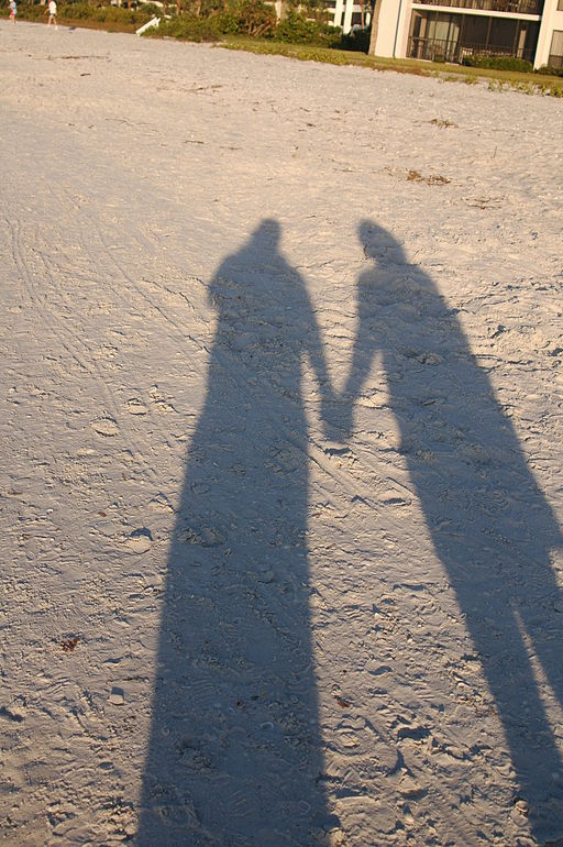 two hand-holding shadows