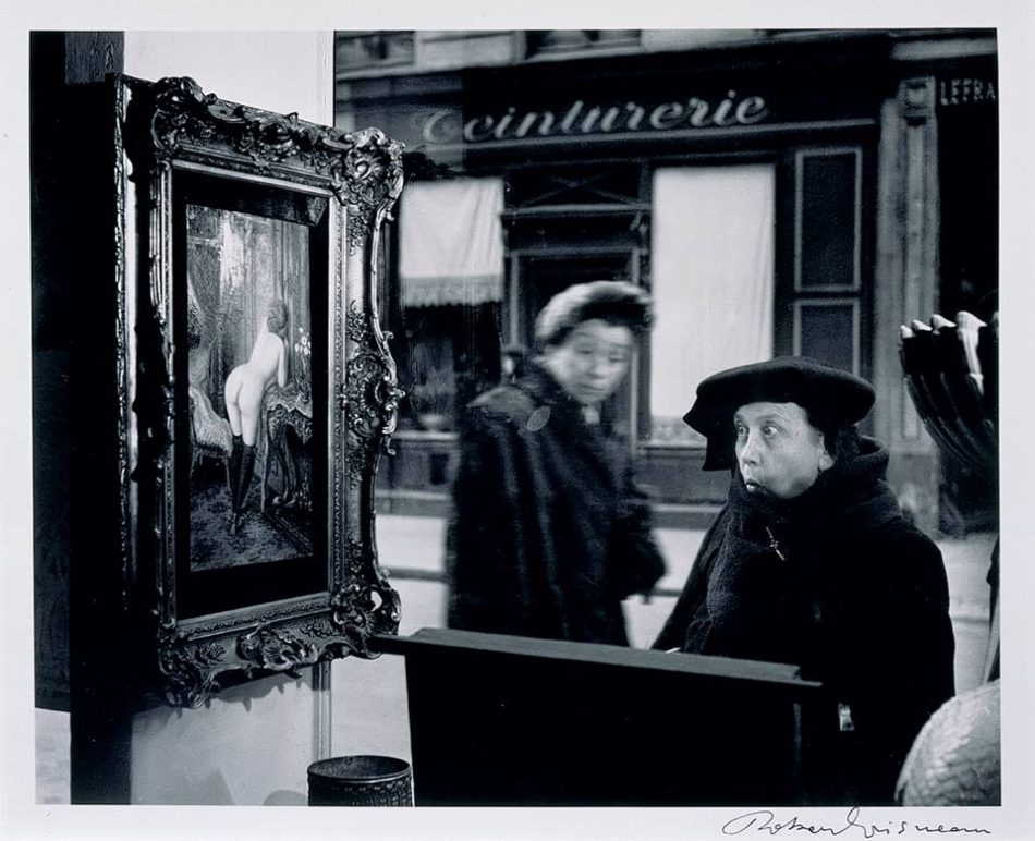 women looking at vintage art
