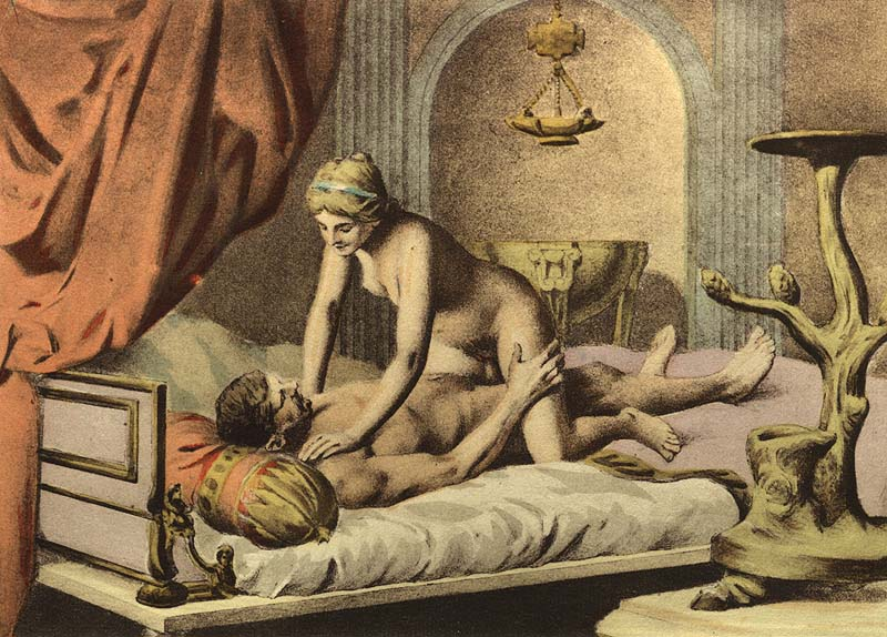Photo of a man and woman in bed