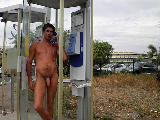 Naked man in a telephone booth.