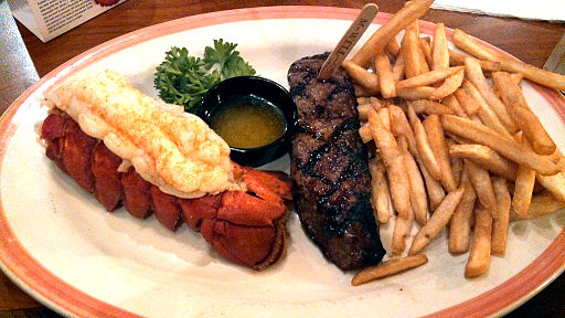 Steak and lobster with fries